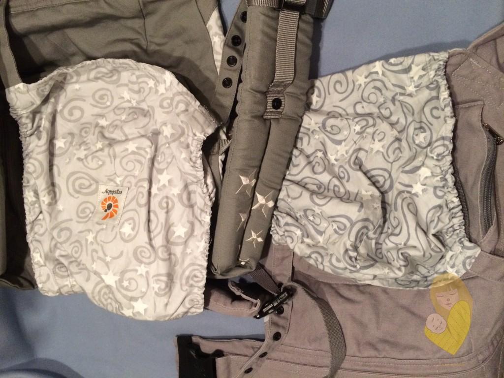 Slika 2 - Ergobaby original sa leve strane, sa logotipom na unutrašnjoj strani kapuljače. Fergo, na desnoj strani, bez logotipa